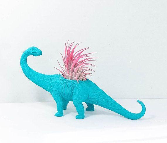 He encontrado este interesante anuncio de Etsy en https://www.etsy.com/es/listing/385243874/plantasaurus-grande-turquesa