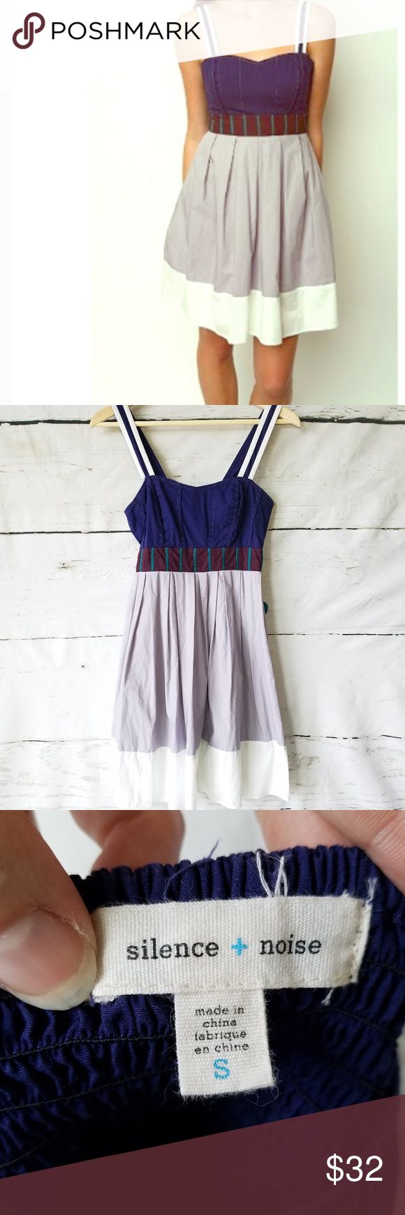 """Silence & Noise Colorblock Navajo Dress Urban Outfitters Silence & Noise colorblock Navajo dress. Size SMALL. Gray and white slightly pleated skirt with turquoise tie back. Chest fabric is purple with gold threading and white lined straps.  Side zipper and elastic stretching on upper back for a more snug fit. Approx measurements: 34"""" length from top of strap to bottom hem.  14.5"""" pit to pit without stretching elastic backing. Waist is 12 1/4"""" This dress is so cute!! Perfect spring or summer…"""