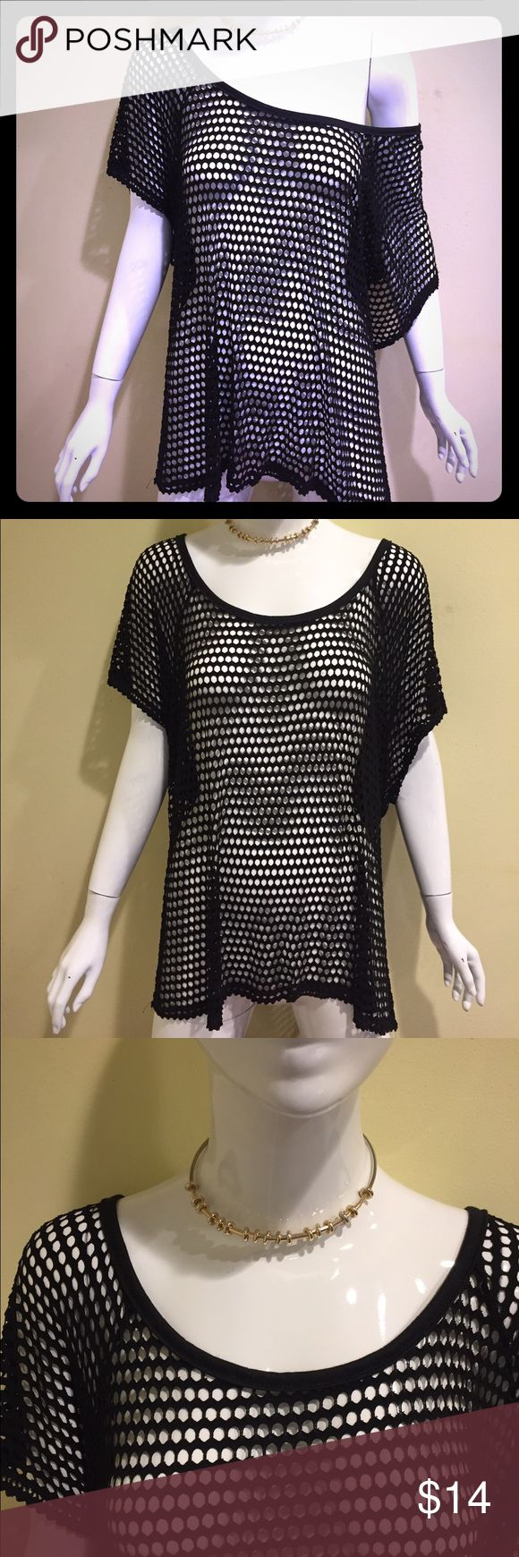Fishnet top Love this top!  black fishnet top, can also be used off the shoulders. Only have 2 in stock Lavish Tops Tank Tops