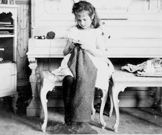 Grand Duchess Anastasia in a very simple moment with none of the royal trappings visible. She looks ike any other little girl.