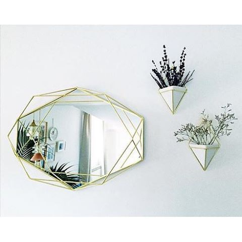 Decorate with brass accents. Styling and photography by Fleur & Olive (instagram @ssandinmyshoes) Products featured: Umbra PRISMA mirror design by Sung wook Park, TRIGG wall vessel design by Moe Takemura