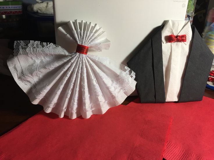 Napkin folding tux & bride dress