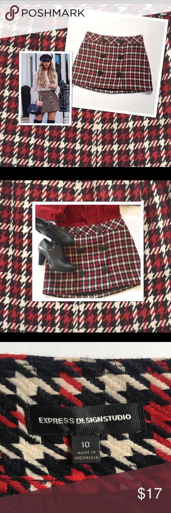 EXPRESS DESIGN STUDIO Red Plaid Mini Skirt Size 10 This adorable EXPRESS DESIGN STUDIO skirt is just perfect for that schoolgirl look :) Size 10 see pics for a better fit :) Skirt is in good preowned condition :)  colors black red and Ivory NOTE : PIC OF MODEL IS FOR STYLING SUGGESTION , skirt is not exact but very similar :) Express Design Studio Skirts Mini