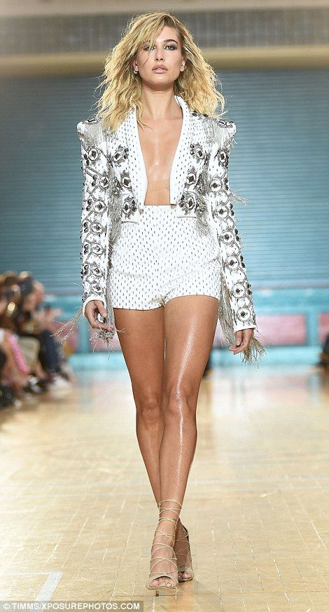 Pounding the catwalk: The 19-year-old American beautyworked a daring short suit - forgoing a shirt for full fashion effect