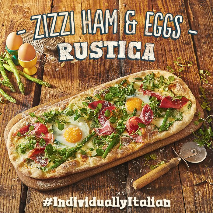 A white base of Fior di Latte & mozzarella, two free range eggs, coppa ham, asparagus, spinach, Grana Padano & smoked garlic oil. #IndividuallyItalian