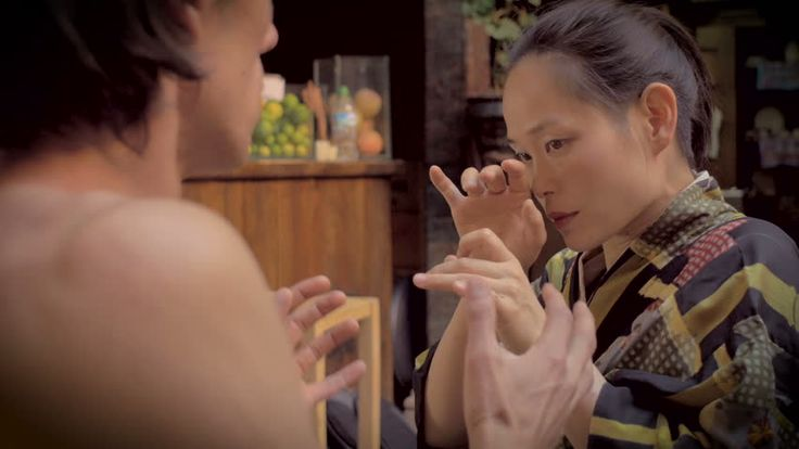A Mexican Man Has An Attact Of DTs At A Bar Or Restaurant Next To His Japanese Girlfriend During A Butoh Dance Performance. Stock Footage Video 12866396 - Shutterstock