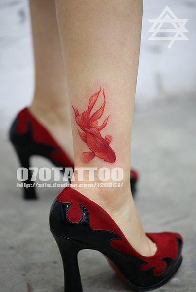 Gold fish tattoo love it