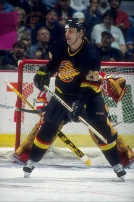 """Big Gino Odjick was one of the more popular Vancouver Canucks of the 1990s and spent much of his time there serving as Pavel Bure's body guard. He was a part of the 1994 Canucks team that reached the Stanley Cup final. Because of his native heritage and his willingness to drop the gloves, he was given the nickname, """"The Algonquin Enforcer."""""""