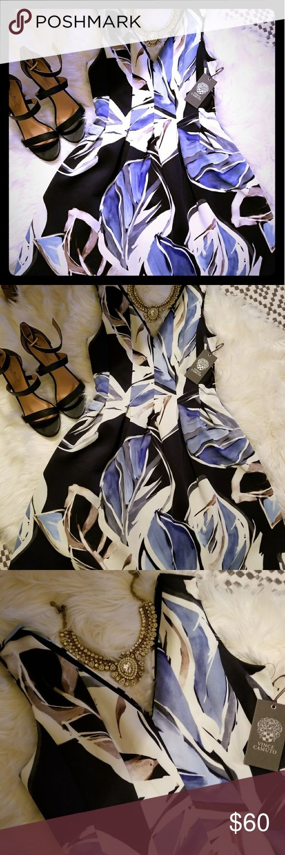 Stunning Vinve Camuto dress Perfect color combination and pattern. Extremely flattering style! Fit and flare. V neck in front and back. Back zipper. Perfect for a night out or a wedding. You will be sure to turn heads in this gorgeous dress. New with tags. Vince Camuto Dresses