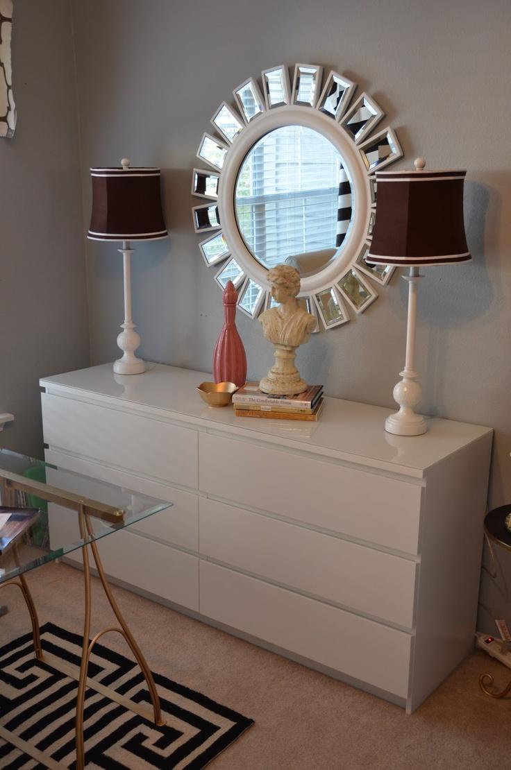 Malm dresser as sideboard, big round sunburst mirror, matching lamps