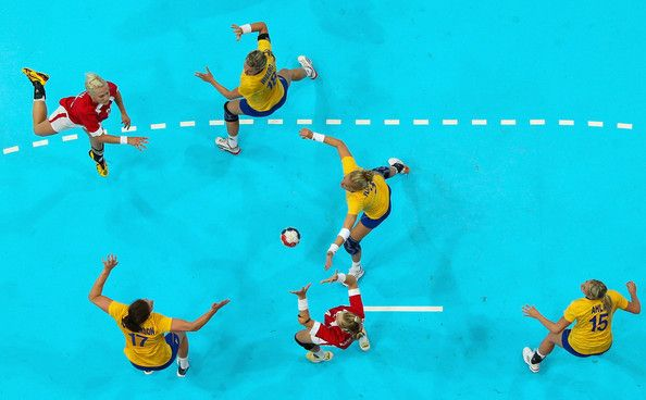 Rikke Skov of Denmark passes the ball in the Women's Handball preliminaries Group B - Match 4 between Denmark and Sweden on Day 1 of the London 2012 Olympic Games at the Copper Box on July 28, 2012 in London, England.