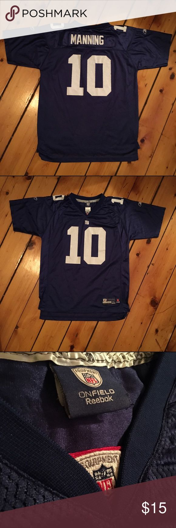 Eli Manning NY GIANTS Jersey Show off your NYG fan style with this game day jersey. Perfect for anyone looking for a new draft pick for a NFL collection *Sized at Kids XL - Fits Adult S/M* Reebok Shirts
