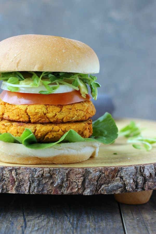 The tastiest veggie burger you will ever eat! Flavored with spices, hot sauce and earthy ingredients to make you insanely satisfied! gardeninthekitchen.com | potluck at ohmyveggies.com