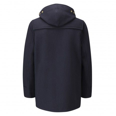 Gloverall   STYLE X1013-52 MEN'S BADGED MID MONTY DUFFLE COAT  FABRIC: 52 Traditional heavier weight plain boiled wool fabric.  £350.00  • MADE IN ENGLAND.  • 80% Wool, 20% Polyamide  • Regular fit  • Removable pin badges  • Fixed hood  • Fully lined in cotton check fabric  • Gloverall branded wooden toggles and jute fastening  Made from boiled wool rich fabric, the badged Mid-Monty is a regular fit Duffle coat. The Gloverall designed embroidered and applique badges scattered across the