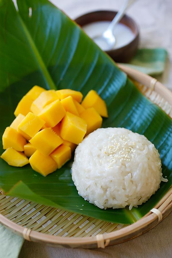 Mango sticky rice - a popular sweet sticky rice with coconut milk and fresh mangoes. This sweet dessert is very popular in Southeast Asia.