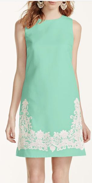 Sleeveless short faille shift bridesmaid dress features ivory lace appliques. Pockets add convenience.