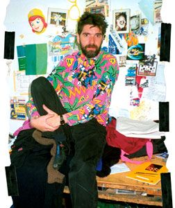 Howard Arkley at his studio, 1991 with some of his source material  photograph  from Carnival in Suburbia, The Art of Howard Arkley  by John Gregory published by Cambridge University Press, 2006