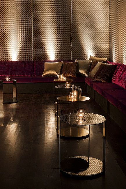 Long banks of plush lounge sofas with tables for your drinks or appetizers.  Particularly love the uplighting and candlelight.