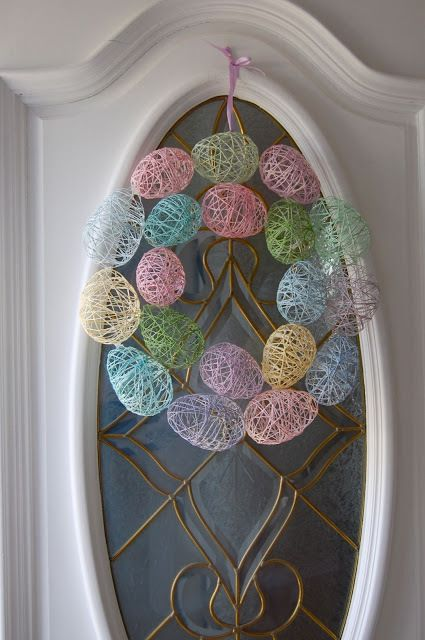 String eggs into a pretty Wreath to display on Your door for Easter! I love the way this looks.