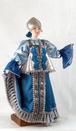A doll in the festive costume from Arkhangelsk Province, Russia. Fashion of the 19-th century.