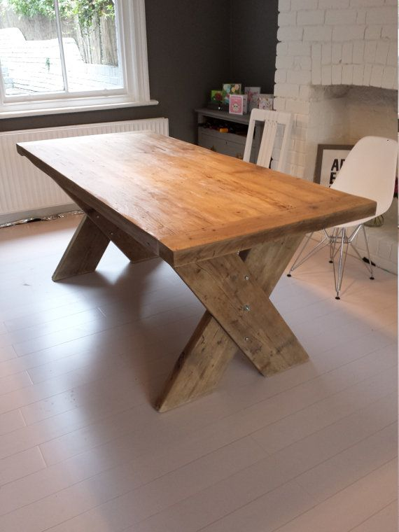 Hand crafted dining table with reclaimed wood top and cross X table legs. This table measures 1.9m long x 87cm wide and can comfortably sit 8,