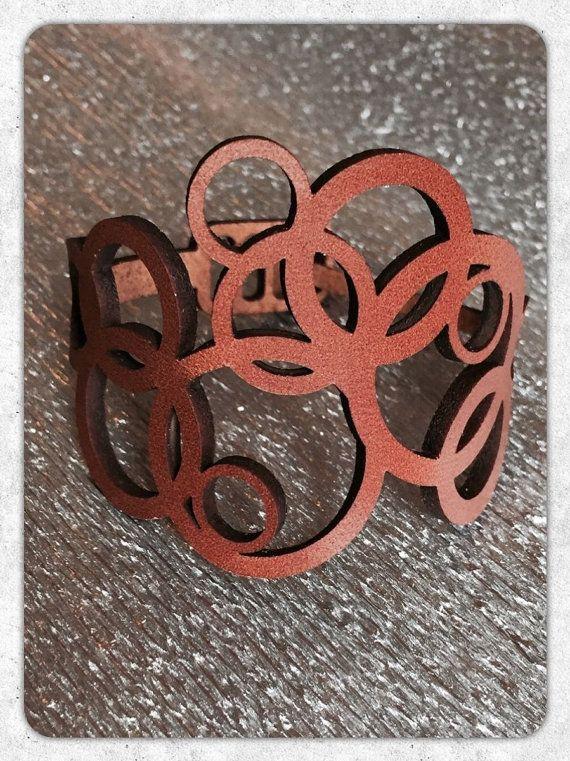 Amazing bracelet in lasercut leather. A great design for spring looks.  www.scintillepreziose.com