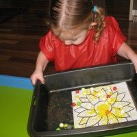 Marble Painting: Rolling marbles through paint on top of a sheet of paper creates some fun and interesting patterns