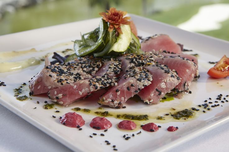 Tuna Tataki - ahi tuna, seared rare, sesame pepper crusted, cucumber, cremini mushrooms, wakame salad, coconut lime marinade, wasabi, miso glaze