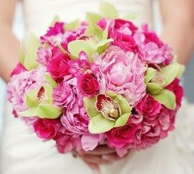 pink peony and orchid wedding bouquet with green leaves
