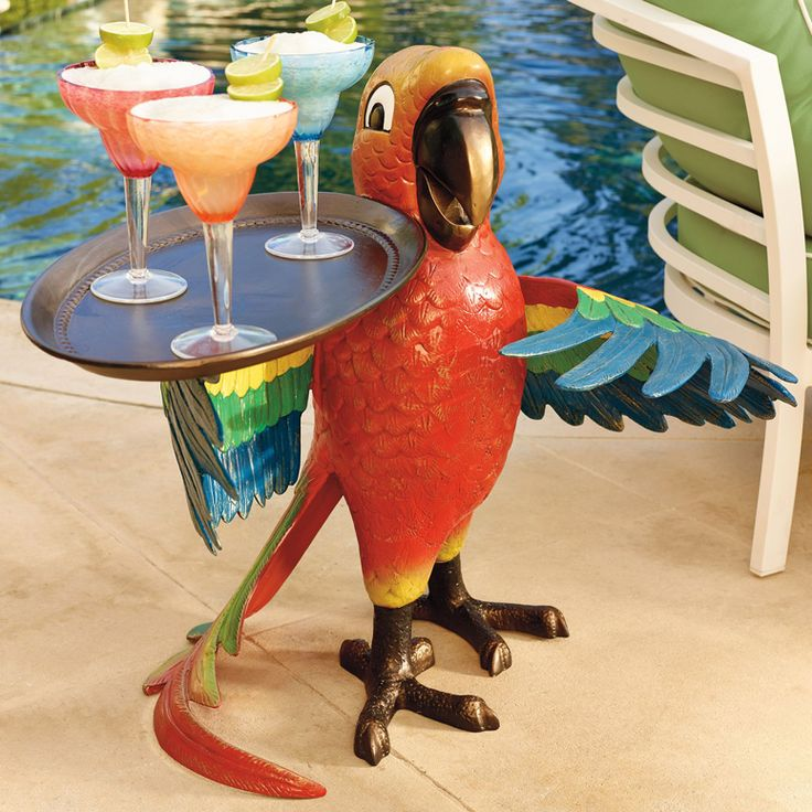 This fun and festive tropical parrot holds a rimmed tray in its wings that's perfect for serving up drinks or snacks at your next party.