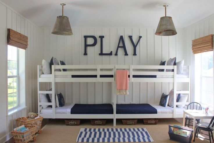 Two Ikea bunk beds painted white and and placed end-to-end. Sleeps four for very little floor space.