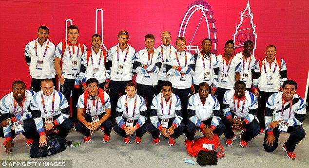 Stars: The Great Britain men's Olympic football team pose for photographs in the reception area of the athletes' village