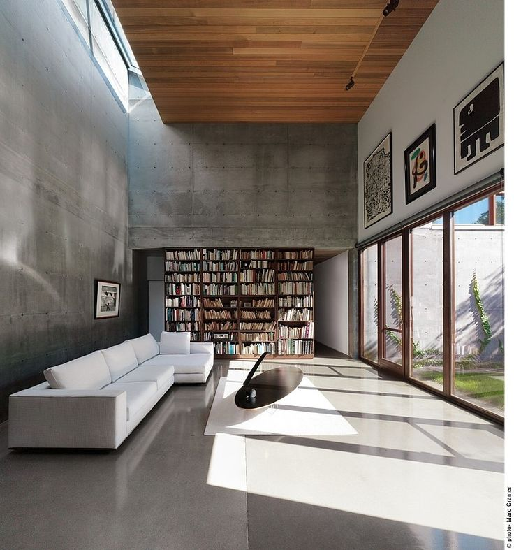 Beaumont House by Henri Cleinge  - very little textural variation, minimalist  - the texture is created by the cement walls and floor, the wood ceiling, the bookshelf, and the light through the windows  -small scale tactile textures
