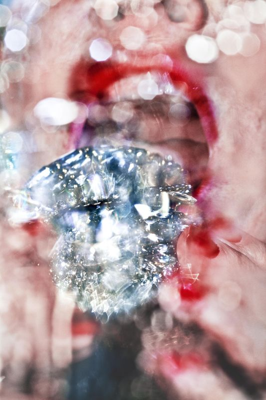 """Marilyn Minter """"Look closely at her glossy gold-encrusted mouths, tongues spewing pearls, or feet teetering on spiky sandals and they suddenly go all blurry—they are, and they aren't, what they appear to be."""""""