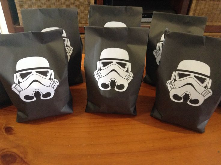 Here are the finished lolly bags.  I sourced the image, printed it on white paper then cut it out and glued it to black paper bags.  He thought they were very cool!