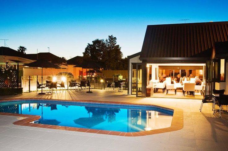 Swimming Pool at Dusk Chateau Marlborough Blenheim, NZ #hotel  #unique #experiences #newzealand #gourmet #journeys #luxury #premium #travel #foodie #foodtravel #bucketlist