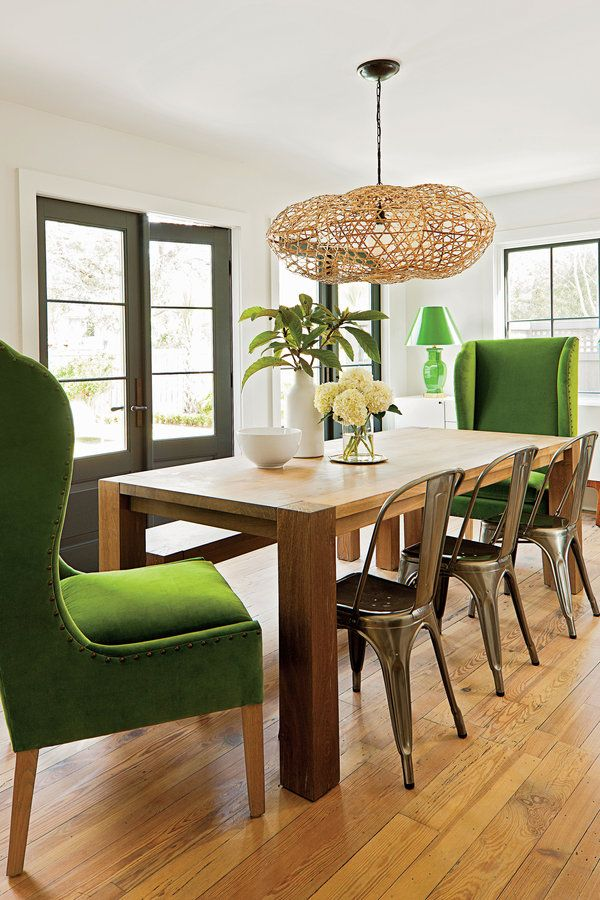 Anchored by a clean-lined Parsons table (left unpolished to stand up to fingerprints), the dining room is both sophisticated and family friendly. Galvanized-metal French Tolix chairs designed in the 1930s and a long bench (which has been known to hold as many as six kids) provide some much needed flexibility and style. See more of this Family-Friendly Remodel