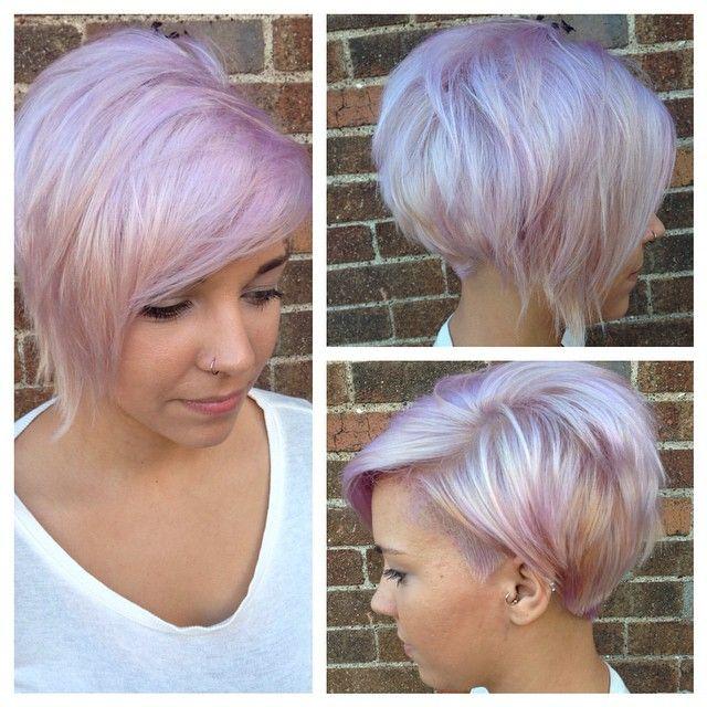 Pastel sherbert, platinum blonde,undercut, tucked, asymmetric, short hair, longer pixie, swooped side bangs.