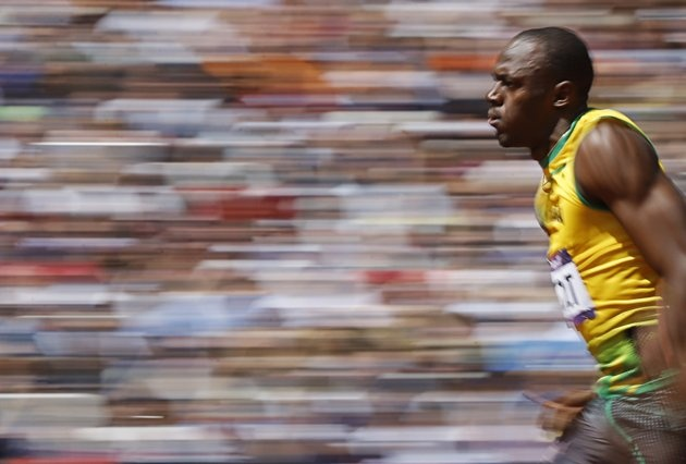 Usain Bolt of Jamaica runs on his way to winning his 100m heat round 1 during the London 2012 Olympic Games at the Olympic Stadium August 4, 2012. (REUTERS/Phil Noble)