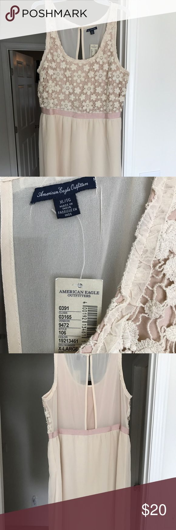American Eagle dress Cream and pink NWT American Eagle dress. Beautiful lace on front with surprise flirty back opening. American Eagle Outfitters Dresses Mini