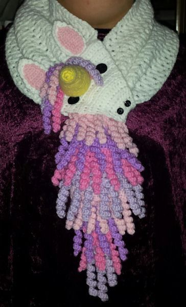 You can find the pattern for this Unicorn pattern at both Ravelry and Craftsy. It is a pattern for the basic unicorn scarf. Everything you need to know to make the basic scarf is in this pattern. Y…