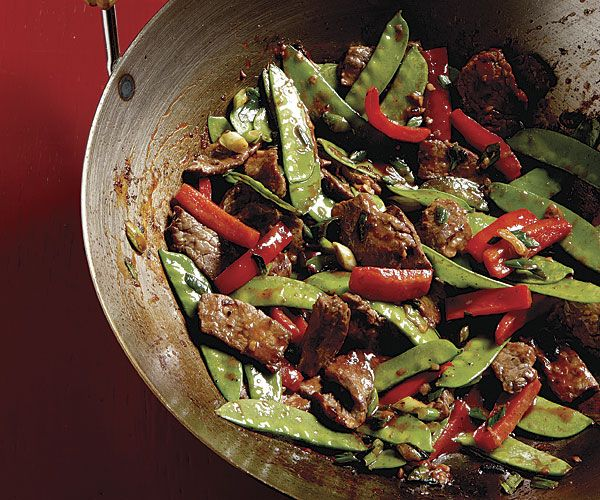 Stir-Fried Chili Beef with Bell Peppers and Snow Peas ~ This spicy dish gets its deep, nuanced flavor from Asian hot bean sauce, which contains soybeans in addition to chiles. It's a rich, complex flavor worth seeking out, but if you can't find it in an Asian market or your supermarket, you can use chili garlic sauce or Sriracha instead.
