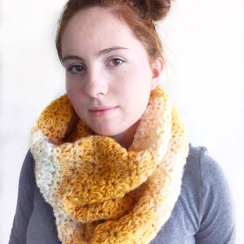 """This scarf! Cowl! Whatever you want to call it is awesome and I made it with one skein of Lion Brand Yarn """"Scarfie"""" in mustard/cre..."""