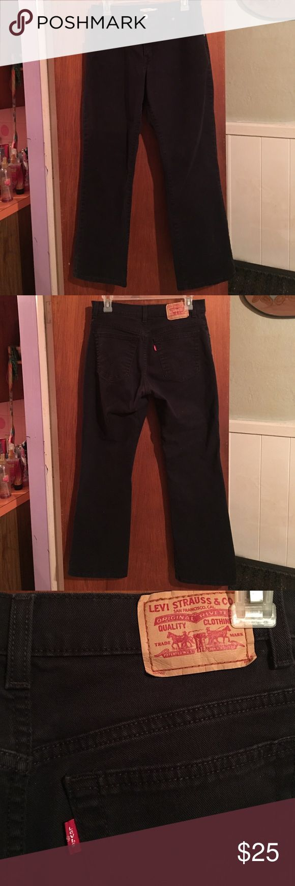 Levi's 550 bootcut black jeans sz 8S Gently worn black levis 550 relaxed, bootcut jeans. The denim does stretch, they aren't faded. Waist is 30 inseam 29 Levi's Jeans Boot Cut