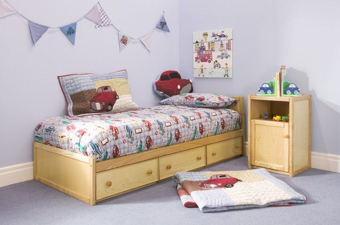 Wooden Toddler Bed  A lovely natural wood Starter Bed for young children and toddlers. The three storage drawers that are incorporated into this quality bed are ideal for storing clothes and toys. Although designed low in height for toddlers, this bed is very well made and strong enough for use by older children and adults. | Childrens Bed Centres