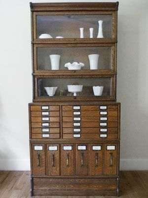 """Early-1900s """"Modular"""" Bookcase    This attractive oak unit was manufactured by Globe-Wernicke, an Ohio-based company that patented a vertical storage system colloquially known as the elastic or modular bookcase"""