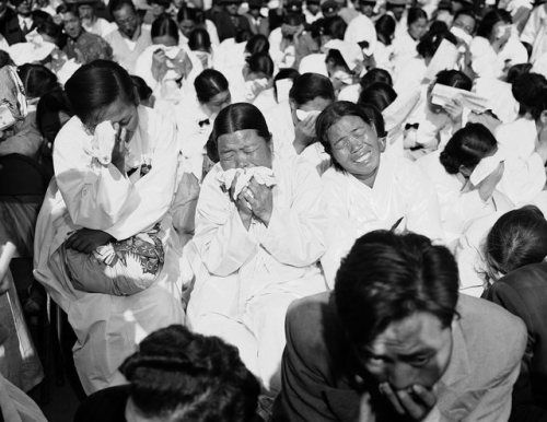 South Korean women weep as they listen to President Syngman Rhee speak at a memorial service in Seoul, October 17, 1953. The service honored the 33,964 South Koreans killed in the last year of the war