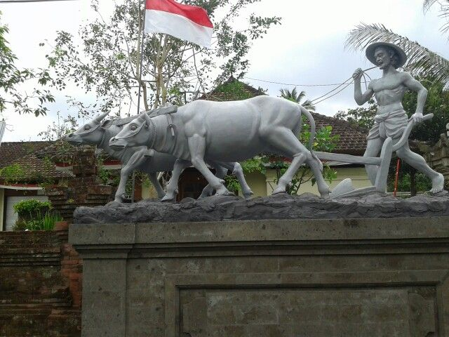 plowing fields bali statue tradition