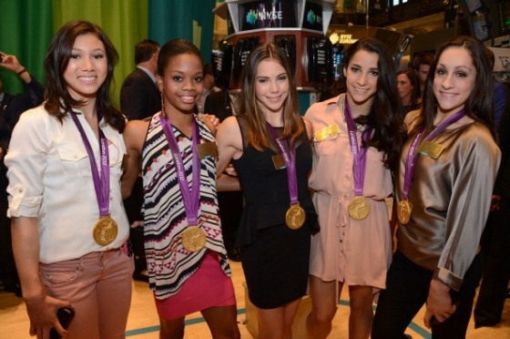 Kyla Ross, Gabby Douglas, McKayla Maroney, Aly Raisman and Jordyn Wieber of the 2012 U.S. Women's Gymnastics Olympic Gold Medal Team ring the closing bell at the New York Stock Exchange on August 14, 2012 in New York City.