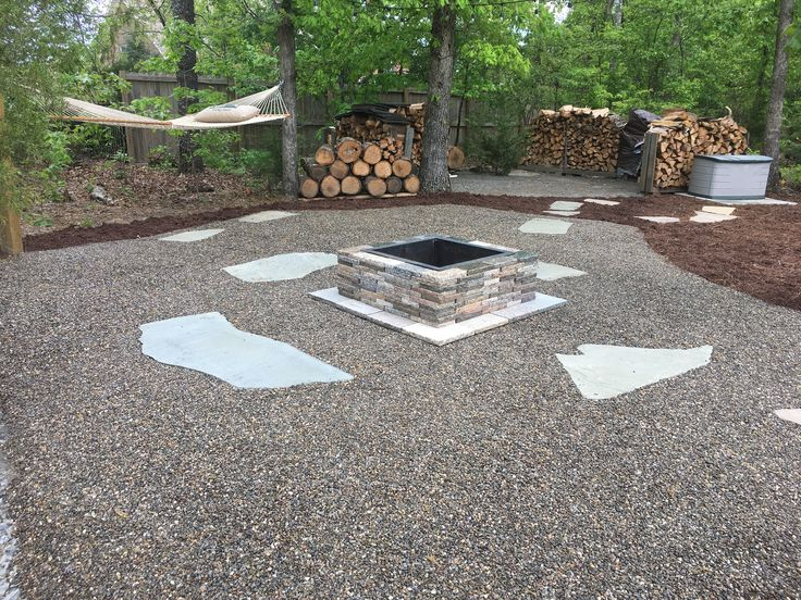 Beautiful Outdoor Living Space Featuring A Fire Pit, Hammock, And Spacious  Seating Area On